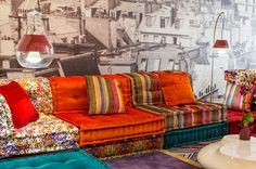 The Mah Jong sofa belongs in the OTT Hall of Fame--crushed velvet, stripes, pixels (?), 70s rust color. Roche Bobois Opens a Second Store in Manhattan--NYT