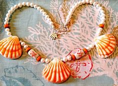 Genuine Lion's Paw necklace, white freshwater pearls, starfish lampworked beads, Czech fire polished beads, beach, sea, ocean, wedding by EbbTideArts on Etsy