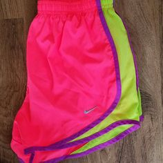 Nike DRI FIT Womens Running Shorts Pink Small Aloha! This item is a pair of LIKE NEW women's Nike Dri Fit running shorts, size small. These shorts are in a vibrant pink / yellow / purple and are just super cute! Interior lining is in great condition and stain free. Mahalo for browsing! Nike Shorts