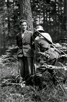 """A German soldier ties the hands of a captured Slovenian partisan prior to his execution on Mala Poljana mountain in the Kamnik-Savinja Alps. Near Lom pod Storžičem, Tržič, Slovenia, Yugoslavia. Summer 1942."" This was taken August 22nd 1941, and that is Franc Sešek of Bukovica."