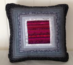 Quilted pillow in magenta and grey. About 16x16 by AnnBrauer