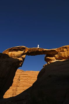 Bedouin on a stone brigde in the Wadi Rum, Jordan
