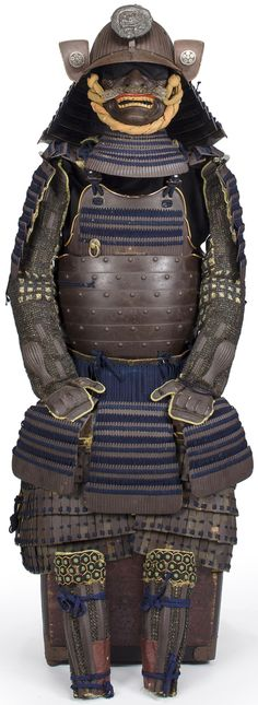 Armor by Saotome Ietada, Edo period, circa 1690-1720, do, helmet and menpo in russet iron, accentuated with matching-russet lacquer components laced in blue kiritsuke lacing, sixty-two plate suji kabuto   bowl signed [ ] shu ju Saotome Ietada, silvered dragon maedate, menpo with a bristle mustache and gilt-iron teeth, ni-mai yokohagi okegawa do hinged at the top section and fitted with seven sections of five-lame kusazuri, o-sode, oda gote; kawara haidate, shino suneate.