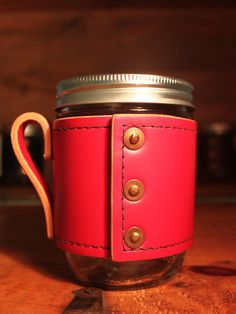 Red leather mason jar, so stylish...  Thats a good coffee mug !!! :-)