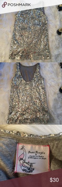 """Free People Sparkle Mini Dress Gorgeous sparkle mini dress from Free People. Size 2. Sequins on the outside, cotton gray lining on the inside. Super short and lower back make this dress a knockout! Vintage. Used, but in great shape! Could be considered a top because of how short the dress is, from underarm seam to bottom hem is 20 inches. Would recommend this for people under 5'3"""" and size 0 UPDATE: model wears size 0 and is 5'1"""" Free People Dresses Mini"""