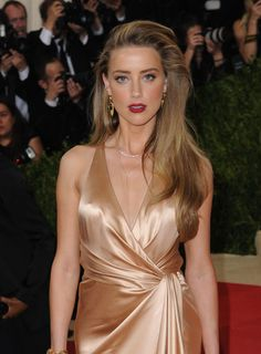 Celebrities Uncensored • Amber Heard Pokies at the Met Gala Event