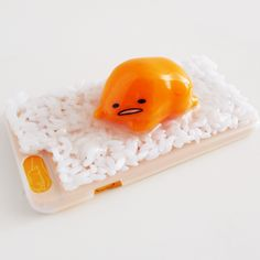 Ok, so it's not a DIY cell phone case- it's a licensed Sanrio product- but it's super awesome anyway!   Gudetama 3D Rice iPhone 6 Case