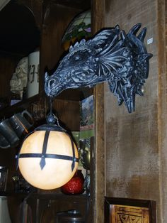 A very unique wall sconce...if you happen to love gargoyles!