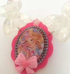 Such a pretty necklace and you'll love it too!! Sweet lady lovely locks pendant trimmed in vintage rhinestone and complimented with new and vintage beads and sparkly glitter bows!