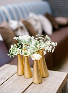 simple gold vases will always have our hearts  Photography by http://msp-photography.com,