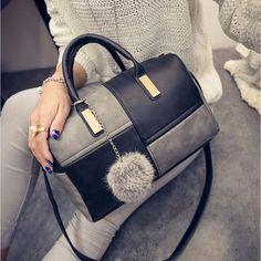 Leather Patchwork Hand Bag by Shunvbasha