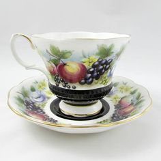 Beautiful vintage bone china tea cup and saucer made by Royal Albert. Pattern is Kent in the Country Fayre Series. Tea cup and saucer are black with fruit. Gold trimming on cup and saucer edges. Excellent condition (see photos). The markings read: Royal Albert Bone China England Country