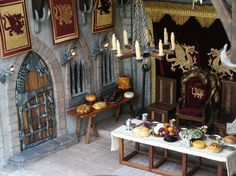 Dining Hall showing the forged-iron Dragon Gate door, the dragon torches on the wall and most of the feast on the tables.