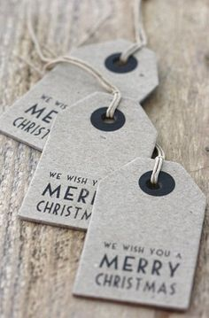 Make a large tag with simple writing on the bottom and leave room for a family photo. Cute Christmas card idea!