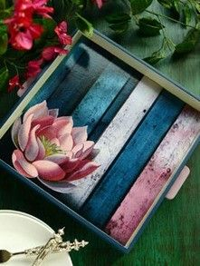 These hand painted wooden trays reflect a modern Mughal sensibility. The lotus motif set against the beautiful texture of wood amalgamates with the clean shape and lines of this piece. Use them to serve your guests during festive gatherings or as catchalls on desks, coffee tables and consoles.