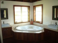 "master bathrooms with tub between the cabinet | The master bathroom ""His"" side:"