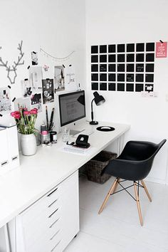 This home office provides plenty of minimalist charm, with a simple white foundation and wall decor to add interest. #organization