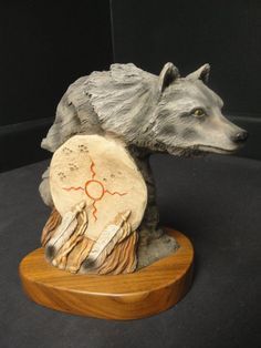 """Outstanding Limited Edition Artist signed carved """"Spirit Wolf"""" sculpture…Wolf with dream catcher sitting on a solid wood/walnut base. Signed to the bottom right: N. Rose."""