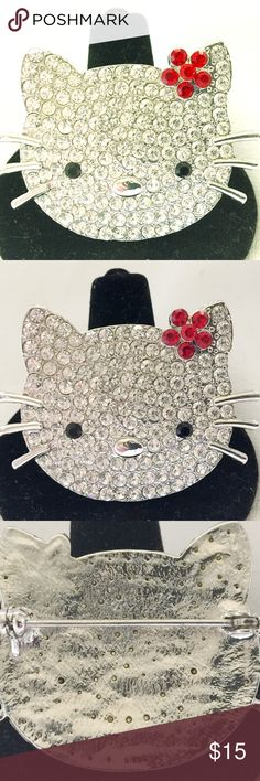 """Hello Kitty Pin From my personal closet, cute Hello Kitty rhinestone pin with red flower. In great condition, no stones missing. Silverplated backing. Measures 1.75"""" whiskers to whiskers. Just over an 1"""" tall Hello Kitty Jewelry Brooches"""