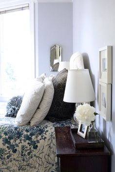 fresh flower, wood nightstand, and blue and white... cozy