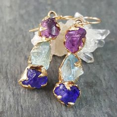 byangelineCreating new earrings this week. I made a pair for myself from amethyst, aquamarine and tanzanite. #rawgem #showyourcouture #gemstoneearrings