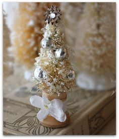 <3 Can use small stem ware pieces turned upside down and spray painted with metallic paints and glitter.