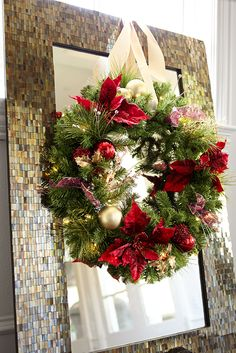 Who says Christmas wreaths are just for doors? Place them on mantels, mirrors or anywhere you want to welcome the holidays. Pier 1's Pre-Lit Poinsettia Wreath is a shining example, featuring the deepest reds, greens and golds you'll see all season, thanks to lush faux winter foliage and lustrous ornaments.