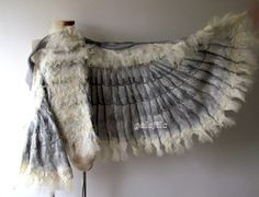 Winged shawl Wings scarf Felted scarf, costume wings, Nuno felted scarf, White owl wings felt wings feather women felt collar by Galafilc   This felted scarf was made of soft merino wool and silk fabric through a wet felting process. Scarf is very warm, delicate. Scarf was decorated with raw