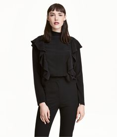 Check this out! Long-sleeved blouse in woven cupro fabric with a sheen. Stand-up collar, decorative ruffles at front and back, concealed zip at back, and cuffs with slit and button. - Visit hm.com to see more.