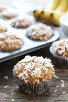 Whole Wheat Banana Coconut Muffins Recipe on twopeasandtheirpod.com These healthy muffins are easy to make and are great for breakfast or snack time!