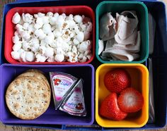 White cheddar popcorn, deli turkey, strawberries, Laughing Cow cheese, crackers.