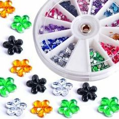 1200X Nail Art Tips Glitter Rhinestone Decoration+Wheel by Ufener. $3.19. Approximately 1200pcs Nail Art Rhinestones/Glitter. Nail decoration. Clean the surface of your nails, brush the base polish, place it onto nails. Seal with a clear top coat. Easy to apply on natural or artificial nails. Flower shape 12 colors, 100pcs for each color Diameter: approx. 3.2mm