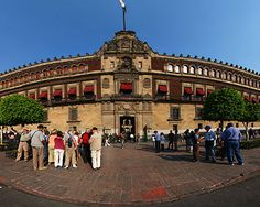 The National Palace, is the seat of the federal executive in Mexico. It is located on Mexico City's main square, the Plaza de la Constitución. Used and classified as a Government Building, the National Palace, with its red tezontle facade,  fills the entire east side of the Zócalo. This site has been a palace for the ruling class of Mexico since the Aztec empire