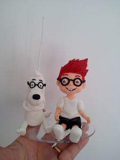Vela com os personagens modelados em porcelana fria (biscuit). Frete por conta do cliente. R$ 60,00