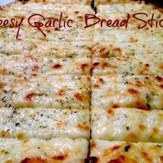 Cheesy Garlic Bread recipe - perfect in my pizza oven. Kids LOVE this!