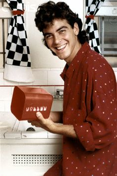 George Clooney Cincinnati native look at him so goofy and happy here this is the look he had on roseanne show when he dated character Jackie