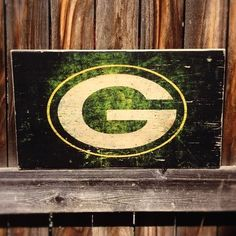 Hey, I found this really awesome Etsy listing at https://www.etsy.com/listing/205182277/green-bay-packers-team-logo-wooden-wall