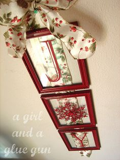 dollar tree frames, and either paint the letters on, or get those small chipboard letters and paint them the same color as the snowflake! and dollar tree ribbon. yesness.