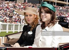 Princess Beatrice of York and Princess Eugenie of York arrive in a horse drawn carriage on the opening day of Royal Ascot at Ascot Racecourse on June 14, 2011 in Ascot, United Kingdom.
