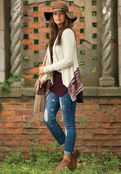 Send out stylish vibes in this tribal bordered waterfall cardigan and distressed cuff jeans. Pair it with a folkloric floppy hat and fringe crossbody to capture that boho feeling. -CatoFashions
