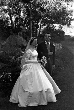 "boston area, 1957  bride and groom posing for wedding photos  originally labeled ""robbie's marriage"", set features photographs of friends and family, gathered for a wedding. part of an archival project, featuring the photographs of nick dewolf"