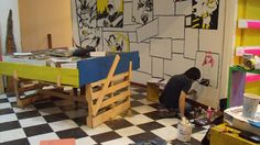 Cool indie comic shop in Costa Rica, where the local artists are all pitching in to paint the walls.