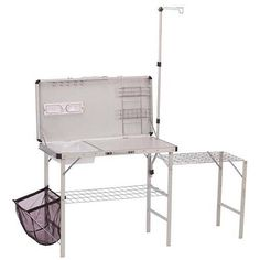 Coleman Camp Kitchen Deluxe - Walmart.com  This is absolutely a must have. half the fun of camping is cooking meals!  makes for easy prep, cooking and washing while freeing up space at the picnic table. Mom has one, works great!