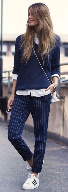 Office look | Striped pants sneakers and sweater over white blouse