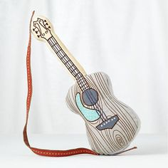 The best instruments for your little ones are the silent ones! A plush guitar toy will let their imagination soar without inducing a headache