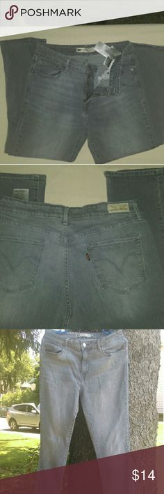 Levi's Mid Rise Skinny Grey Levi's, 30 long, 9.5 rise,  33 waste. 98% cotton and 2% elastine. Levi's Jeans Straight Leg