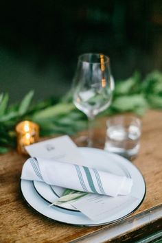 simple table setting with striped napkins - photo by Maria Lamb
