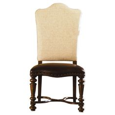 At once regal and rustic, this nailhead-trimmed side chair pairs its upholstered  back with a leather seat and ornately turned legs.