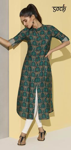 Stately style meets impressive sophistication in this Soch Navy Blue & Teal A-Line Rayon Kurti. Pair this with a cream classic fit churidar and take the stage with confidence or add statement earrings and flats with a hint of bling if an ethnic do beckons Printed Kurti Designs, Silk Kurti Designs, Sari Blouse Designs, Kurta Designs Women, Kurti Designs Party Wear, Churidar Designs, Kurti Sleeves Design, Sleeves Designs For Dresses, Kurta Neck Design