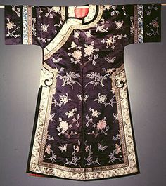 Informal Manchu woman's robe, embroidered with a design of seasonal flowers and butterflies and done in Peking-knot stitch. Made in China late 1800's.